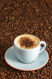 Cappuccino. With chocolate sprinkles on coffee beans Royalty Free Stock Photos
