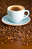 Cappuccino. Set on table with coffee beans Royalty Free Stock Photography