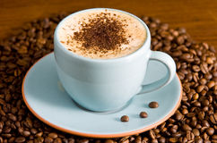 Cappuccino. Set on table with coffee beans Stock Images