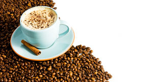 Cappuccino. On white background with coffee beans Royalty Free Stock Photo
