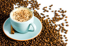Cappuccino. On white background with coffee beans Royalty Free Stock Images