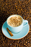 Cappuccino. On white background with coffee beans Royalty Free Stock Image