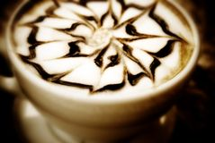 Cappuccino. Macro of cup with nicely decorated coffee cappuccino Stock Photos