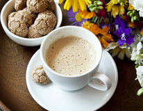 Cappuccino with Amaretti Biscuits and Flowers Stock Images