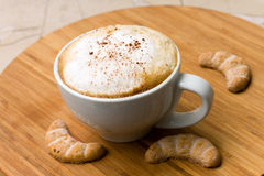 Cappuccino And Sweet Cookies On The Wooden Backgro Stock Photography