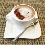 Cappuccino art in a coffee cup Royalty Free Stock Image