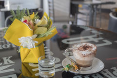 Cappuccino flowers and water Stock Photography