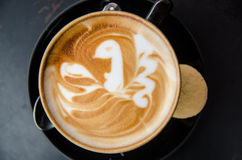 A cappuccino with a bird in latte art Stock Image