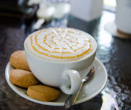 Cappuccino with biscuit. A cup of hot cappuccino with biscuit Stock Photo