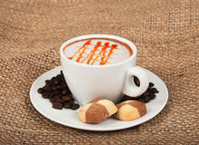 Cappuccino and biscuits Stock Images