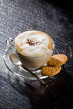 Cappuccino on black glass table Royalty Free Stock Photos