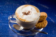 Cappuccino on blue glass table Stock Photo