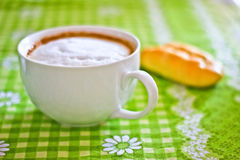 Cappuccino breakfast. A still-life of a cup of cappuccino and a muffin stock image