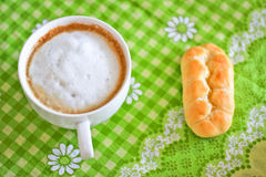Cappuccino breakfast. A still-life of a cup of cappuccino and a muffin Royalty Free Stock Photography