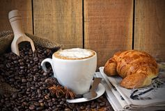 Cappuccino, brioches and newspaper with background Royalty Free Stock Photo