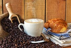 Cappuccino, brioches and newspaper with background. Still life Royalty Free Stock Photography