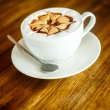 Cappuccino on a brown background Stock Photos