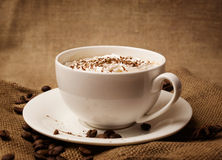 Cappuccino on burlap Royalty Free Stock Photo