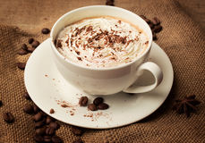 Cappuccino on burlap background Stock Images