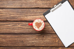 Cappuccino and business tablet with paper. Stock Photos