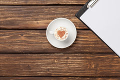 Cappuccino and business tablet with paper. Royalty Free Stock Image