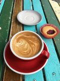 Cappuccino and cake in the morning sunshine Royalty Free Stock Photography