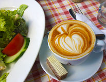Cappuccino with cake on a rustic tablecloth Royalty Free Stock Photos