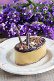 Cappuccino cake on white plate Royalty Free Stock Photo