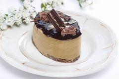 Cappuccino cake on white plate Stock Photo