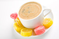 Cappuccino with candies Royalty Free Stock Image