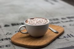 Cappuccino in Ceramic Teacup Beside Teaspoon Stock Photo