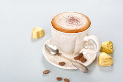 Cappuccino with chocolate candies Stock Photos