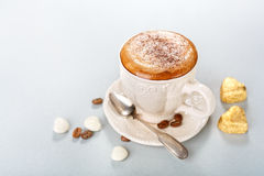 Cappuccino with chocolate candies Stock Images