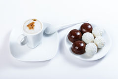 Cappuccino, chocolate candy, candy of coconut, close-up photogra Stock Image
