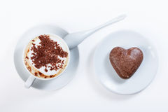 Cappuccino with chocolate chip cookies in a heart shaped. Royalty Free Stock Image