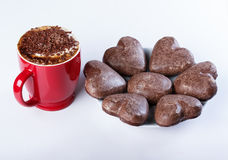 Cappuccino with chocolate chip cookies in a heart shaped red cup Stock Photography