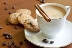Cappuccino with chocolate and cookies Stock Images