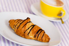Cappuccino and chocolate croissant isolated on whi Royalty Free Stock Images