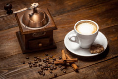 Cappuccino with cinnamon and antique coffee mill Stock Images