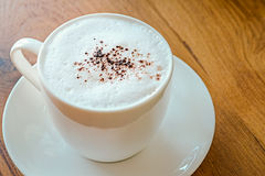 Cappuccino with cinnamon. On a decorative background Stock Images