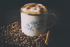 Cappuccino with cinnamon. Delicious cappuccino with cinnamon on table Stock Photography