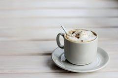Cappuccino with cinnamon Stock Photos