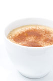 Cappuccino with cinnamon in a white cup closeup Stock Photo