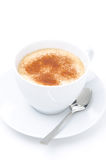 Cappuccino with cinnamon in a white cup isolated Stock Photography