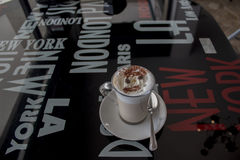 Cappuccino on glass table Stock Photo