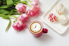 Cappuccino with a clock. A cup of coffee cappuccino with a clock pattern from cinnamon on milk foam stock photo