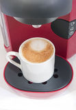 Cappuccino coffe and coffe machine Royalty Free Stock Images