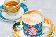 Cappuccino and Coffe cup royalty free stock image