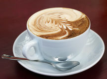 Cappuccino coffee. Espresso topped with foamed milk makes a frothy decorated cappuccino Stock Image