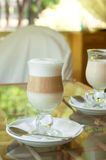Cappuccino coffee. With milky froth in glasses on a glass table outside in a cafe Royalty Free Stock Photography